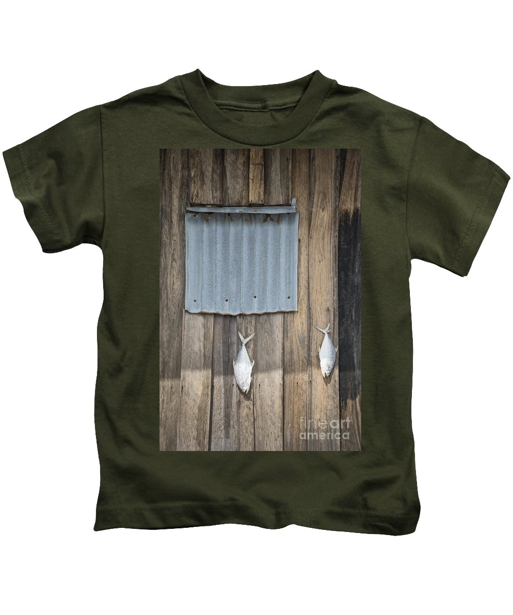 Abstract Kids T-Shirt featuring the photograph Fish Drying Outside Fisherman House by Jacek Malipan