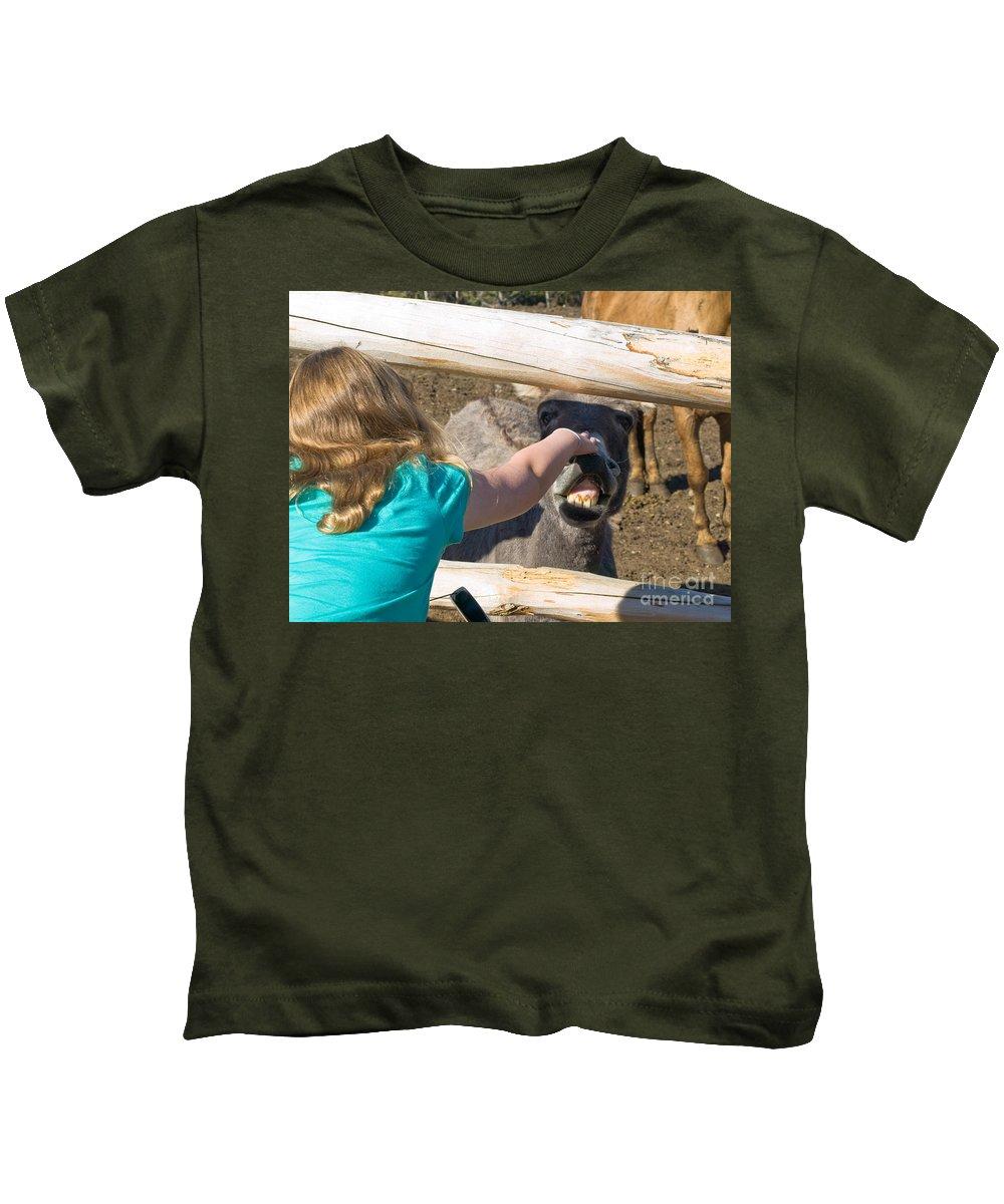 Girl Kids T-Shirt featuring the photograph Girl Pets Donkey by Tara Lynn