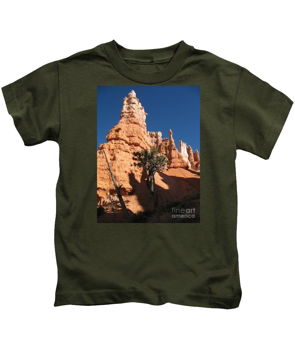 Light Kids T-Shirt featuring the photograph Light And Shadow In The Bryce Canyon by Christiane Schulze Art And Photography