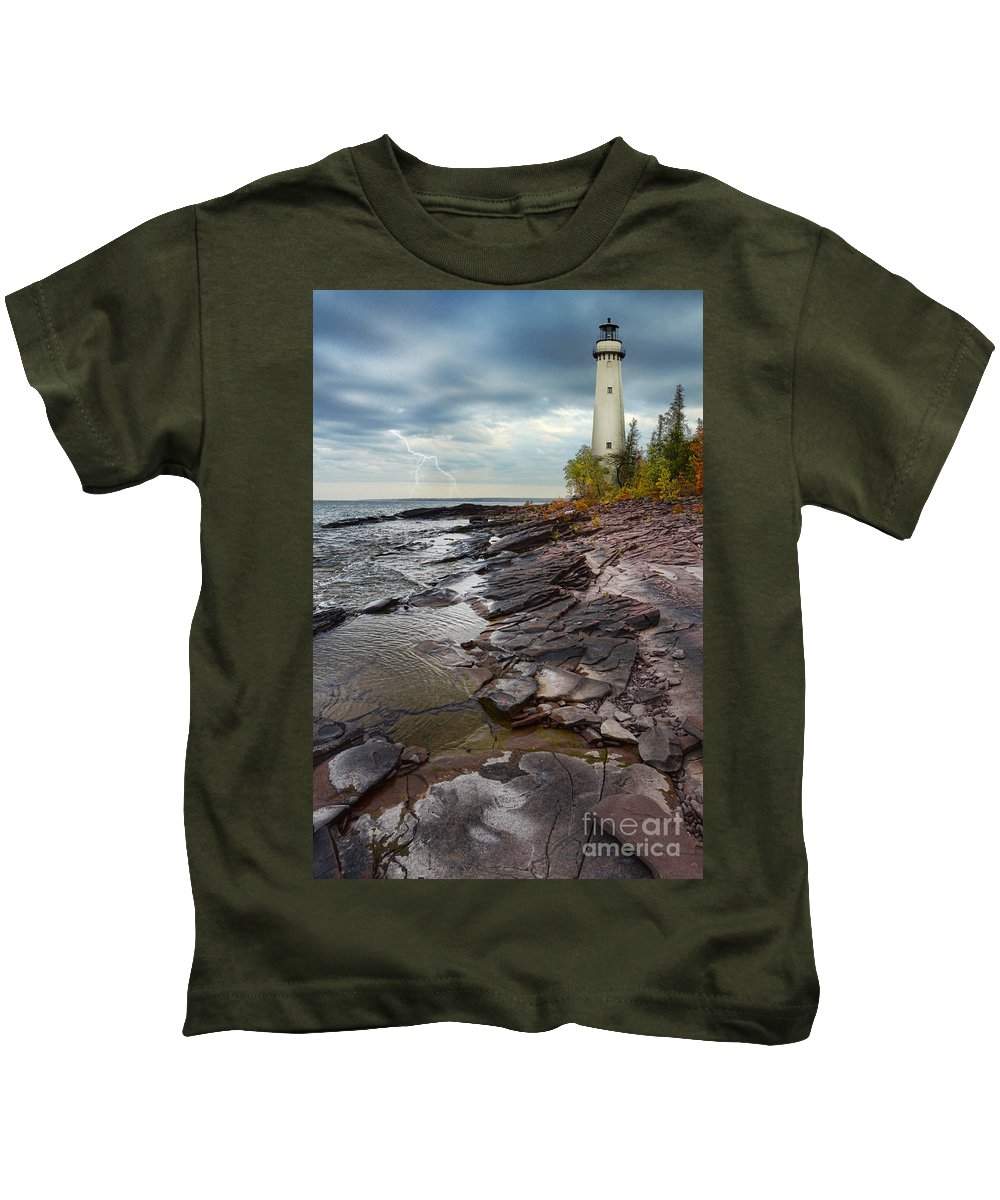 Lighthouse Kids T-Shirt featuring the photograph Lighthouse And Stormy Sea by Jill Battaglia