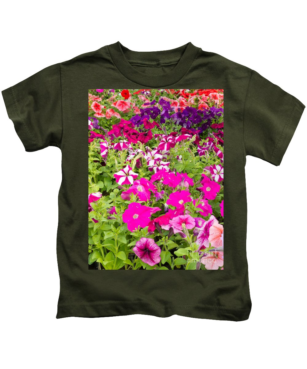Agriculture Kids T-Shirt featuring the photograph Multi-colored Blooming Petunias Background by Stephan Pietzko