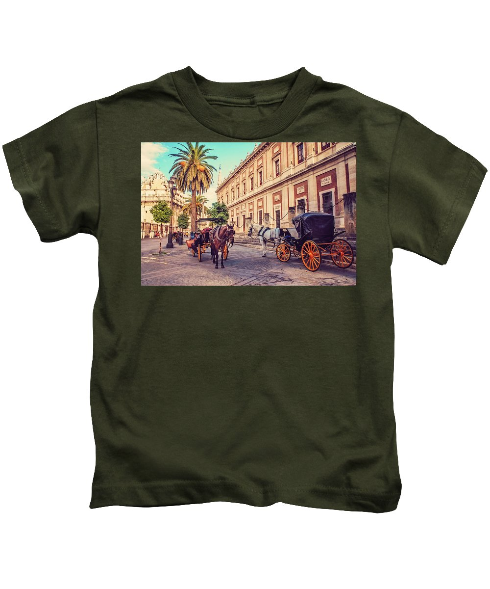 Spain Kids T-Shirt featuring the photograph Noon At Cathedral Square. Seville by Jenny Rainbow
