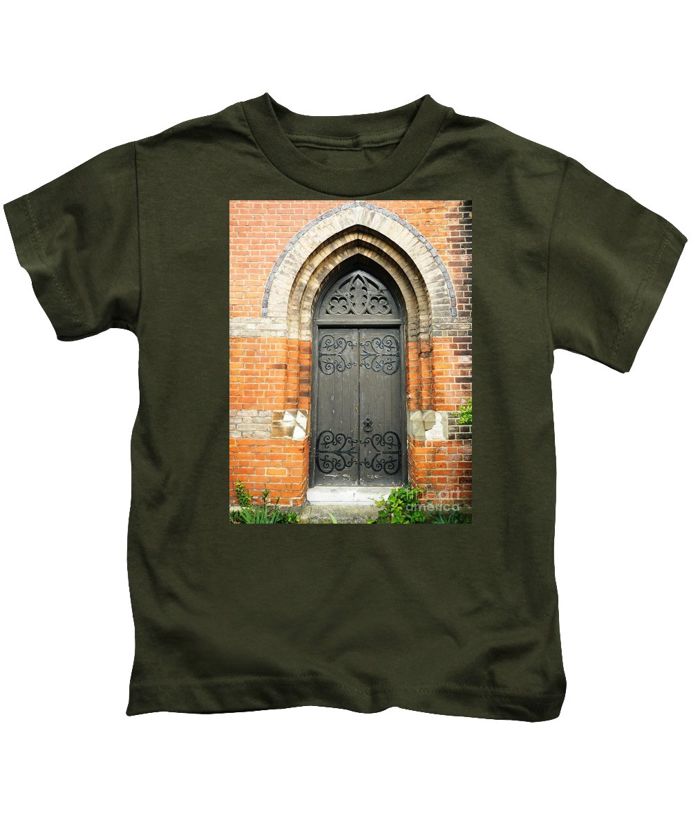 Buildings Kids T-Shirt featuring the photograph Old Church Door by Loreta Mickiene