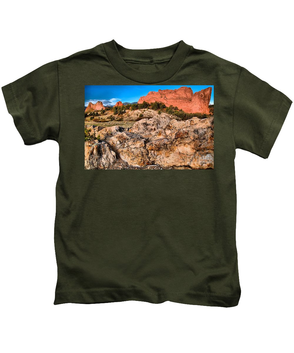 Sunrise At Garden Of The Gods Kids T-Shirt featuring the photograph Red Rocks Over White by Adam Jewell