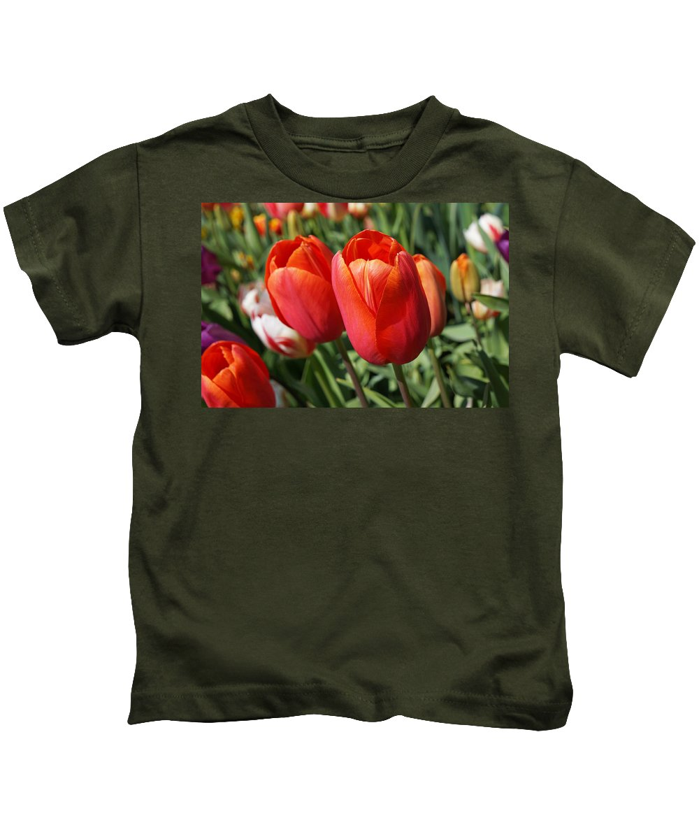 Red Kids T-Shirt featuring the photograph Red Tulips Flowers Pink Orange Tulip Flowers by Baslee Troutman