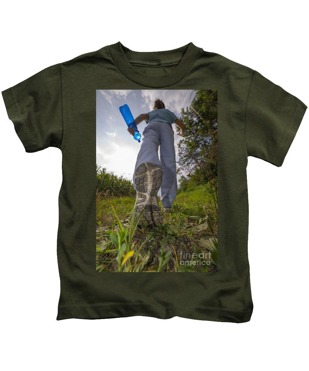 Woman Kids T-Shirt featuring the photograph Running by Mats Silvan