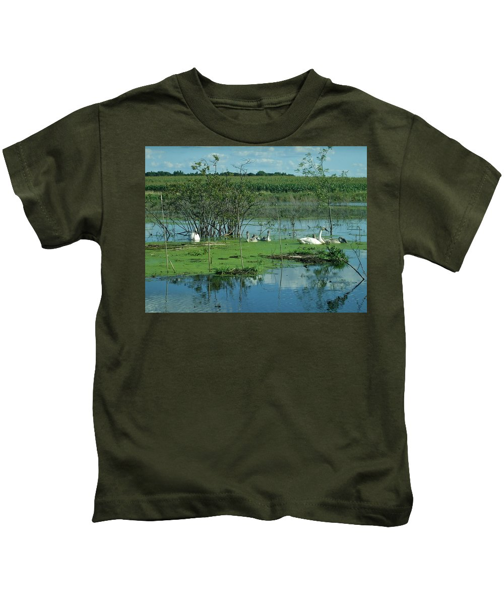 Swans Kids T-Shirt featuring the photograph Safe In The Pond by Susan Wyman