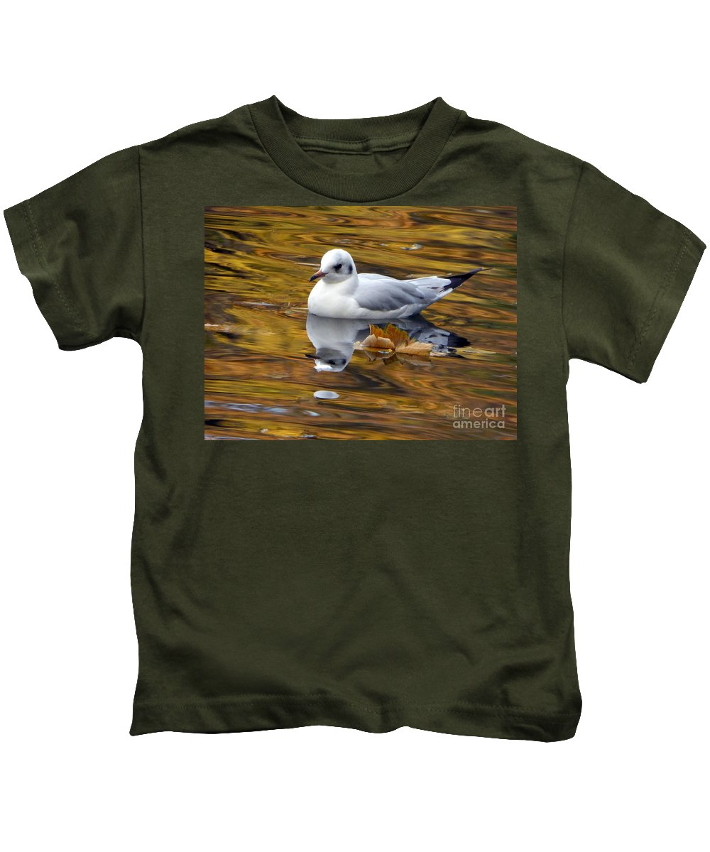 A Collection Of Images In The Lake Kids T-Shirt featuring the photograph Seagull Resting Among Fall Leaves by Nili Tochner