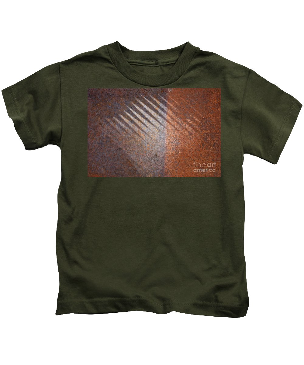 Rust Kids T-Shirt featuring the photograph Shadows And Rust by Carol Groenen
