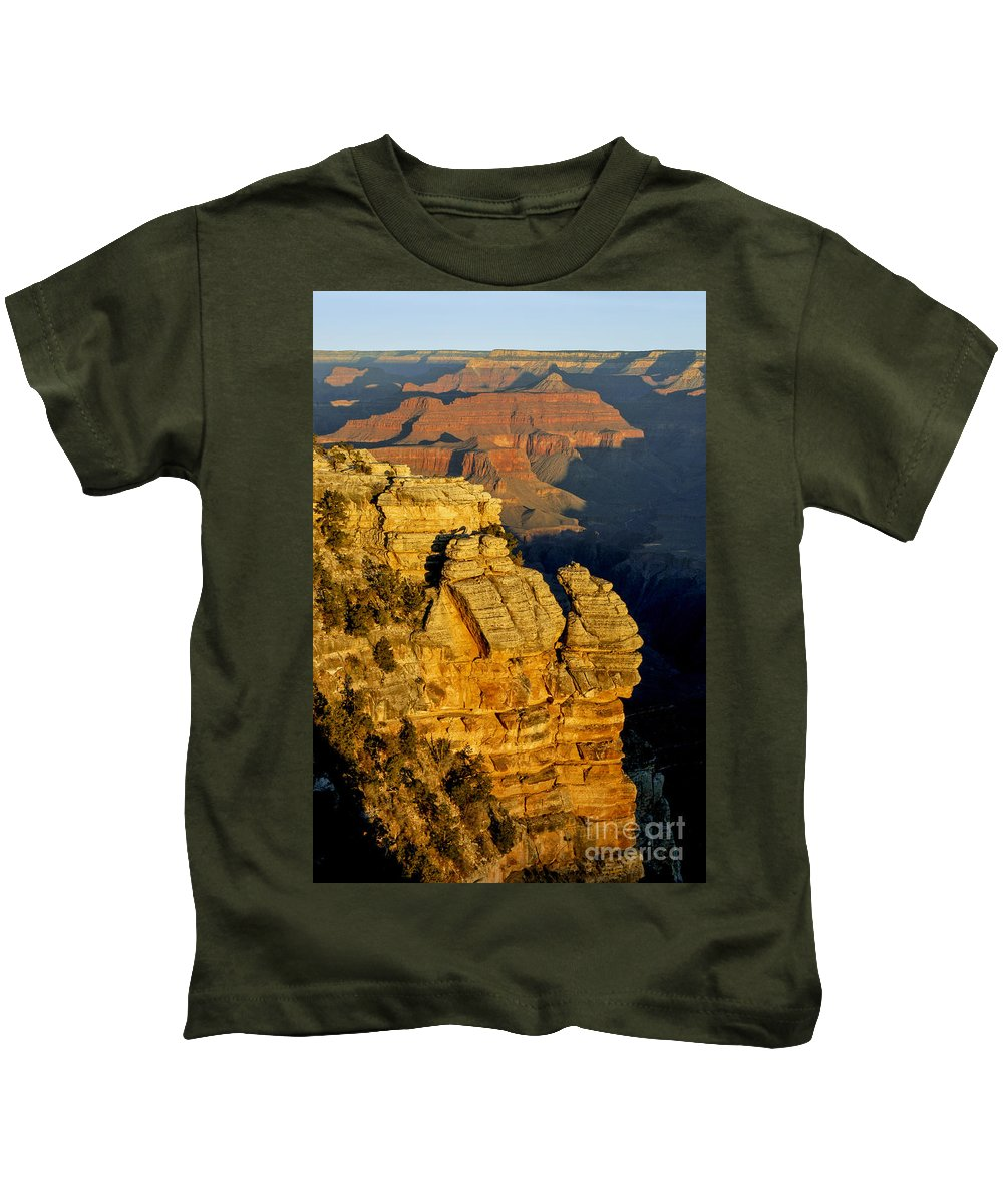 Grand Canyon National Park Arizona Parks Mather Point South Rim Canyons Rock Formations Rock Formation Sunrise Sunrises Landscape Landscapes Landmark Landmarks Kids T-Shirt featuring the photograph Sunrise In The Canyon by Bob Phillips