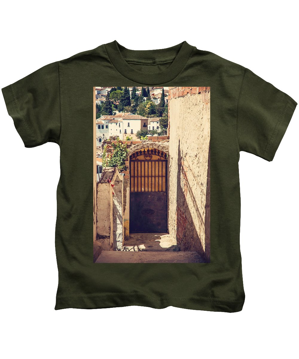 Spain Kids T-Shirt featuring the photograph The Door With Overview Of Ronda by Jenny Rainbow
