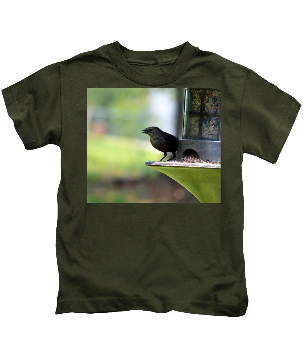 Tiny Seed For A Tiny Bird Kids T-Shirt featuring the photograph Tiny Seed For A Tiny Bird by Maria Urso