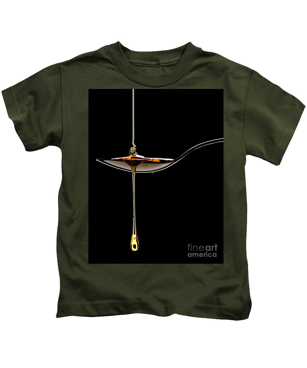 Food Kids T-Shirt featuring the photograph Treacle Dripping Off Spoon by Bailey Cooper
