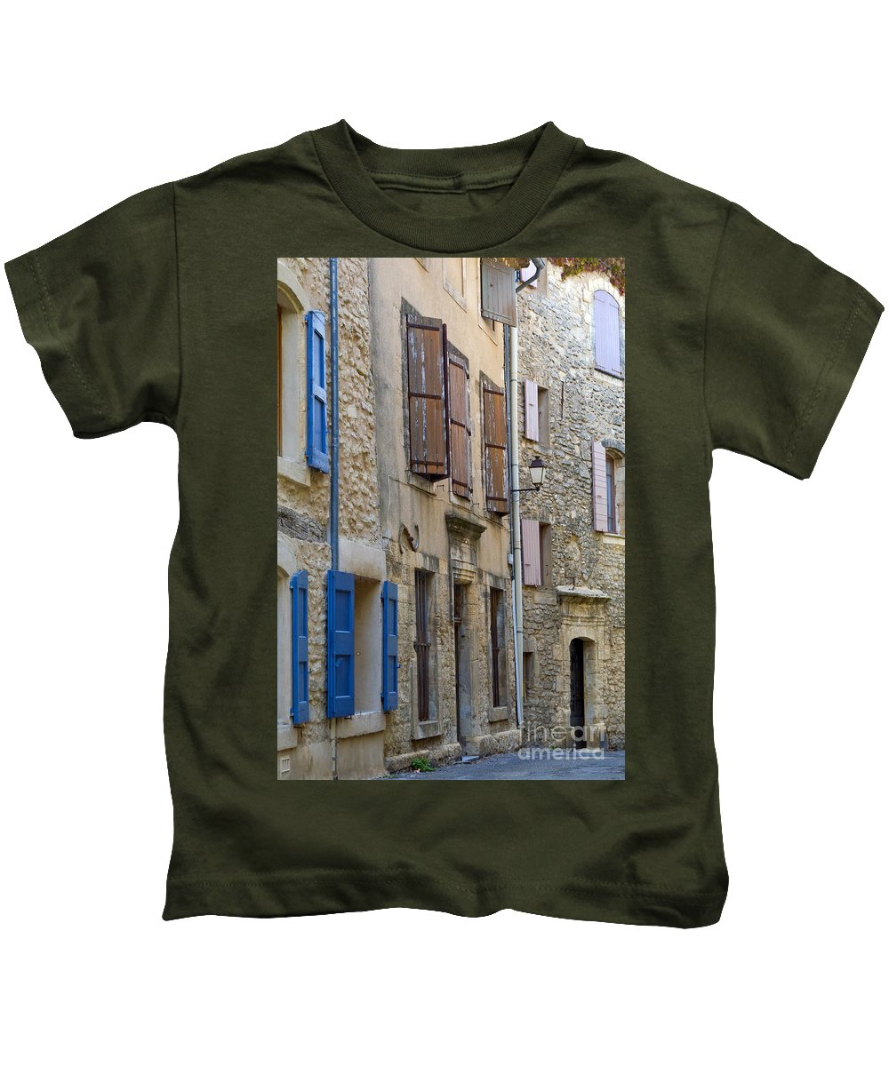 Saignon France Door Doors Window Windows Shutter Shutters Street Streets Stone Structure Structures Home Homes Apartment Apartments Building Buildings Provence Village Villages City Cities Cityscape Cityscapes Architecture Kids T-Shirt featuring the photograph Village Apartments by Bob Phillips