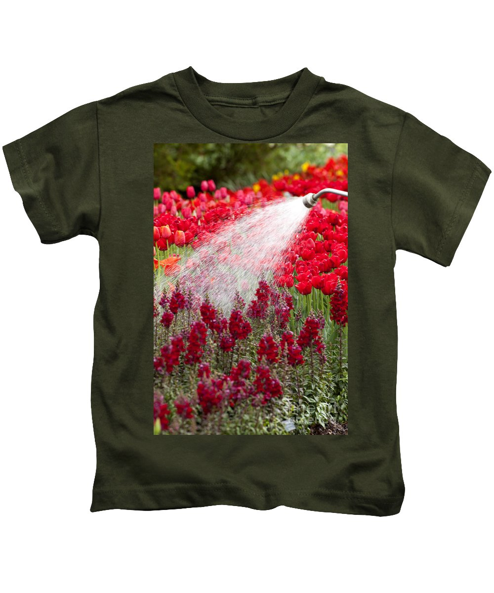 Snapdragon Kids T-Shirt featuring the photograph Watering The Garden by Anthony Totah