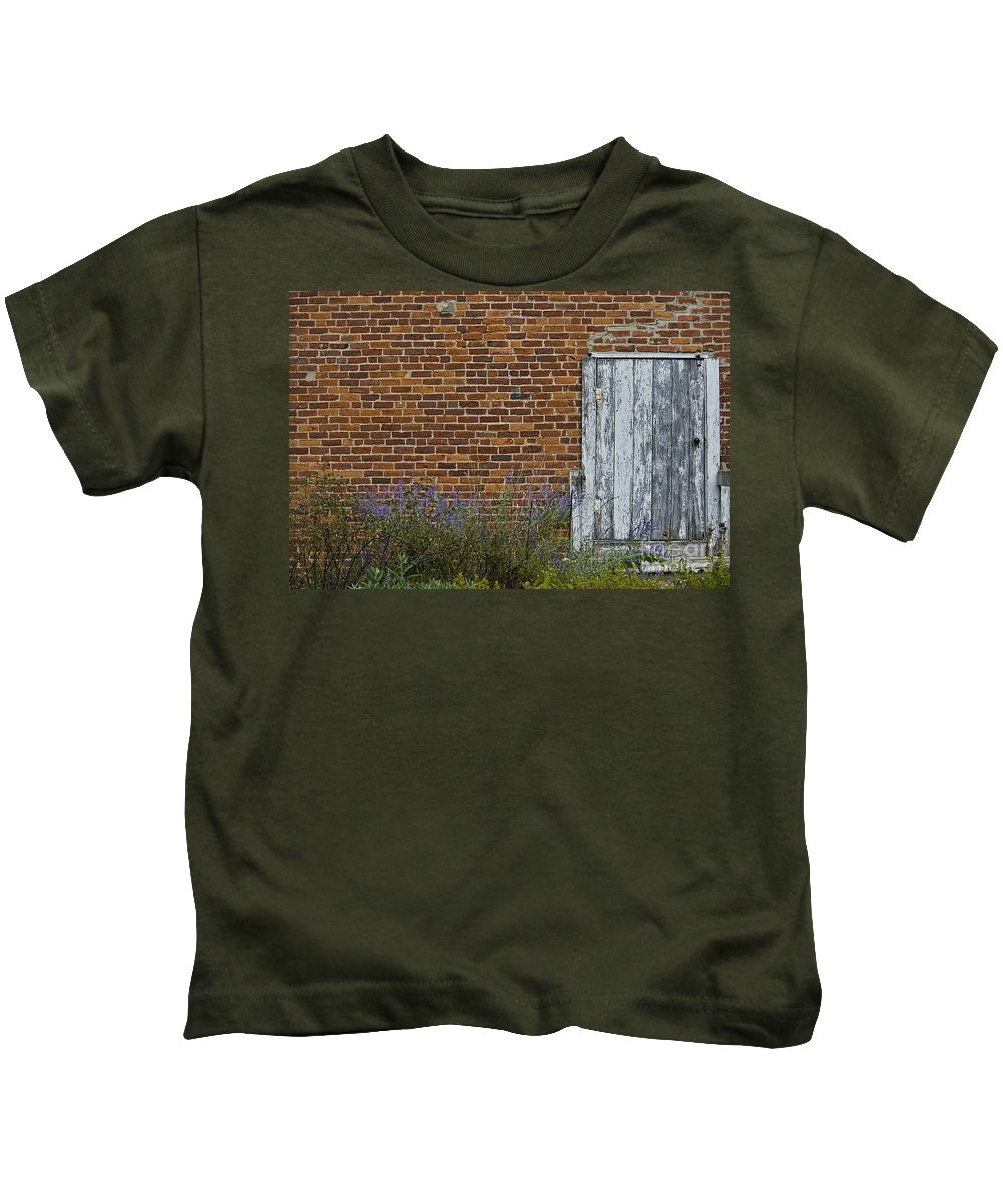 Door Kids T-Shirt featuring the photograph White Door In Brick Building by David Arment