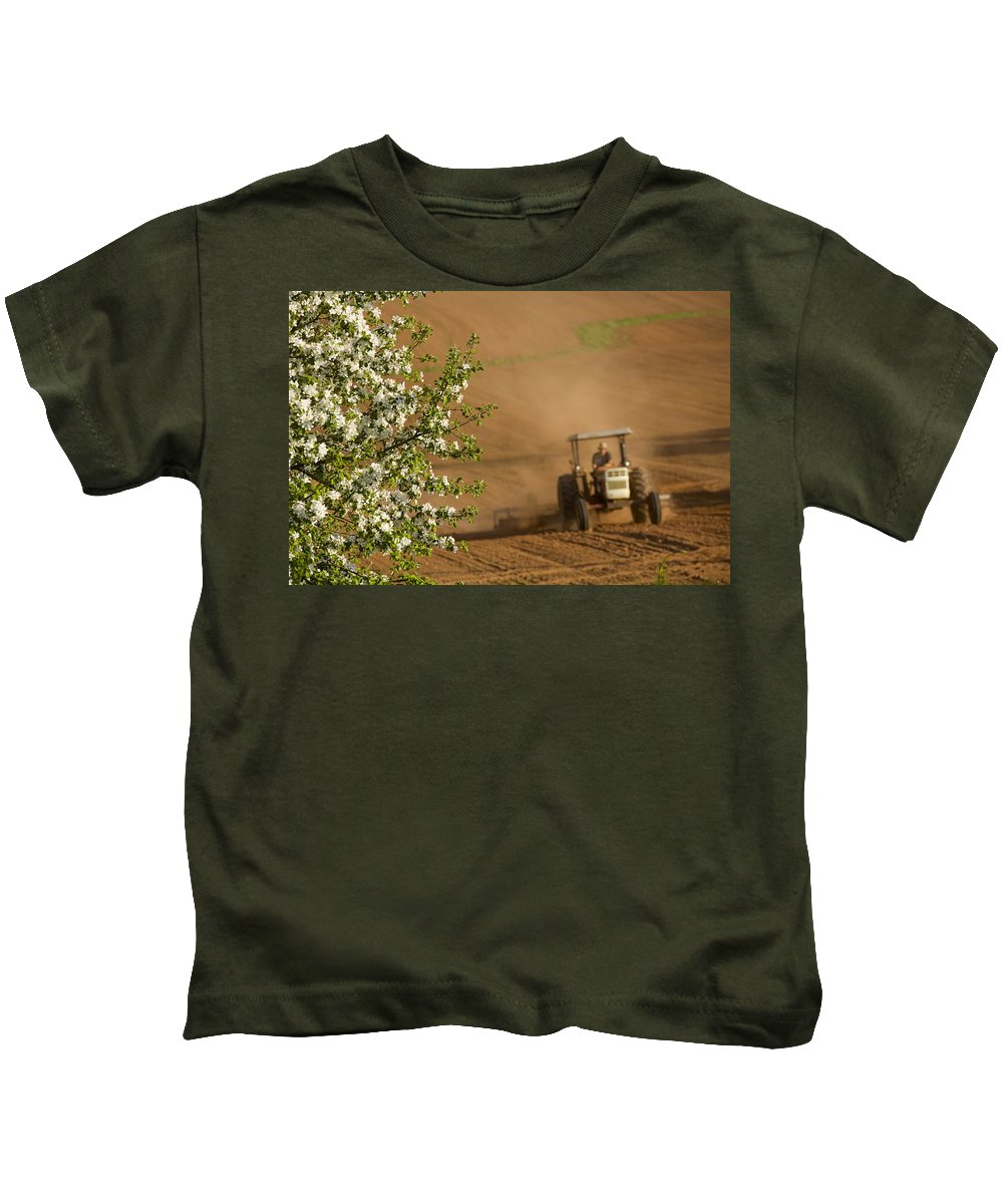 Adult Kids T-Shirt featuring the photograph Apple Blossoms And Farmer On Tractor by John Sylvester