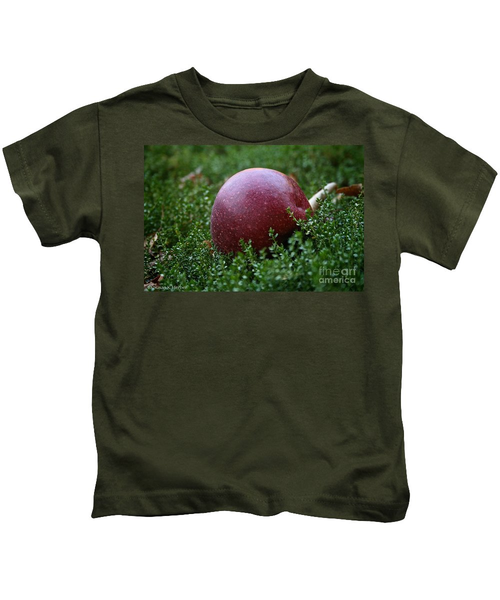 Outdoors Kids T-Shirt featuring the photograph Apple Gravity by Susan Herber