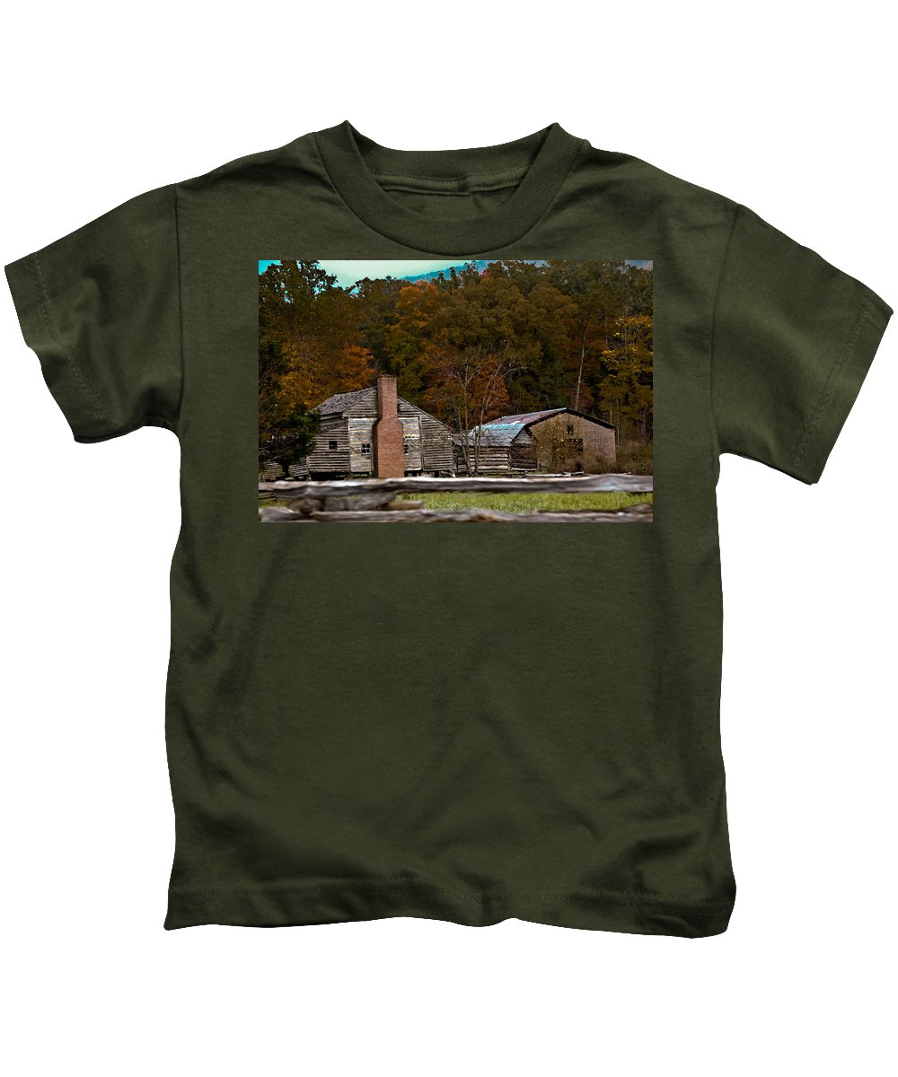 Settlement Kids T-Shirt featuring the photograph Beyond The Fence by DigiArt Diaries by Vicky B Fuller