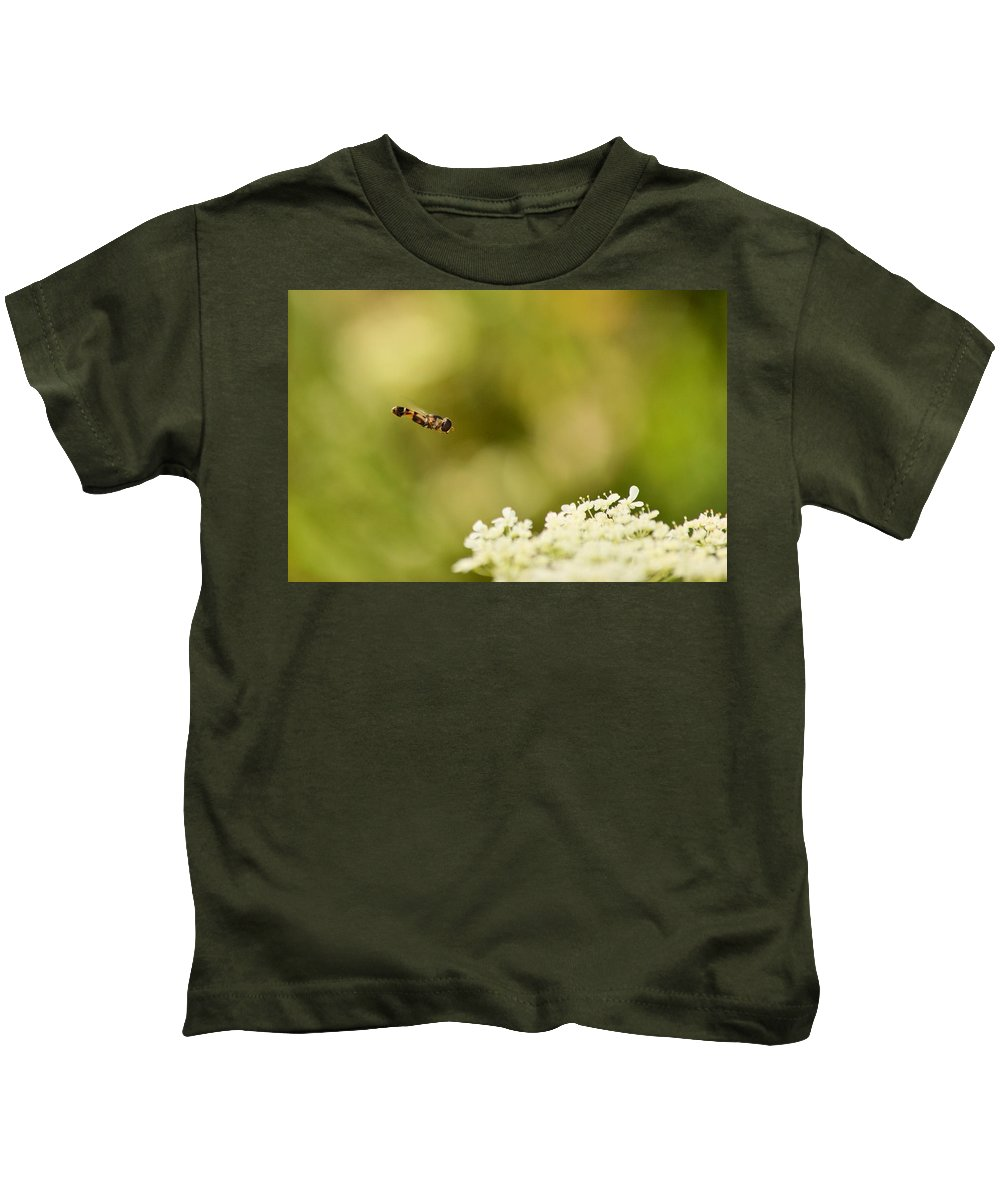 Hover Fly Kids T-Shirt featuring the photograph Hovering Over by JD Grimes