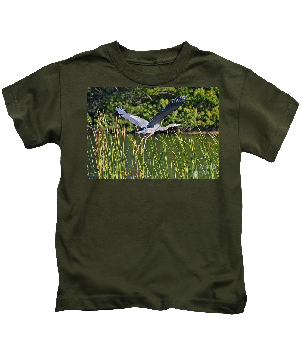 Heron Kids T-Shirt featuring the photograph In Flight by Carol Bradley