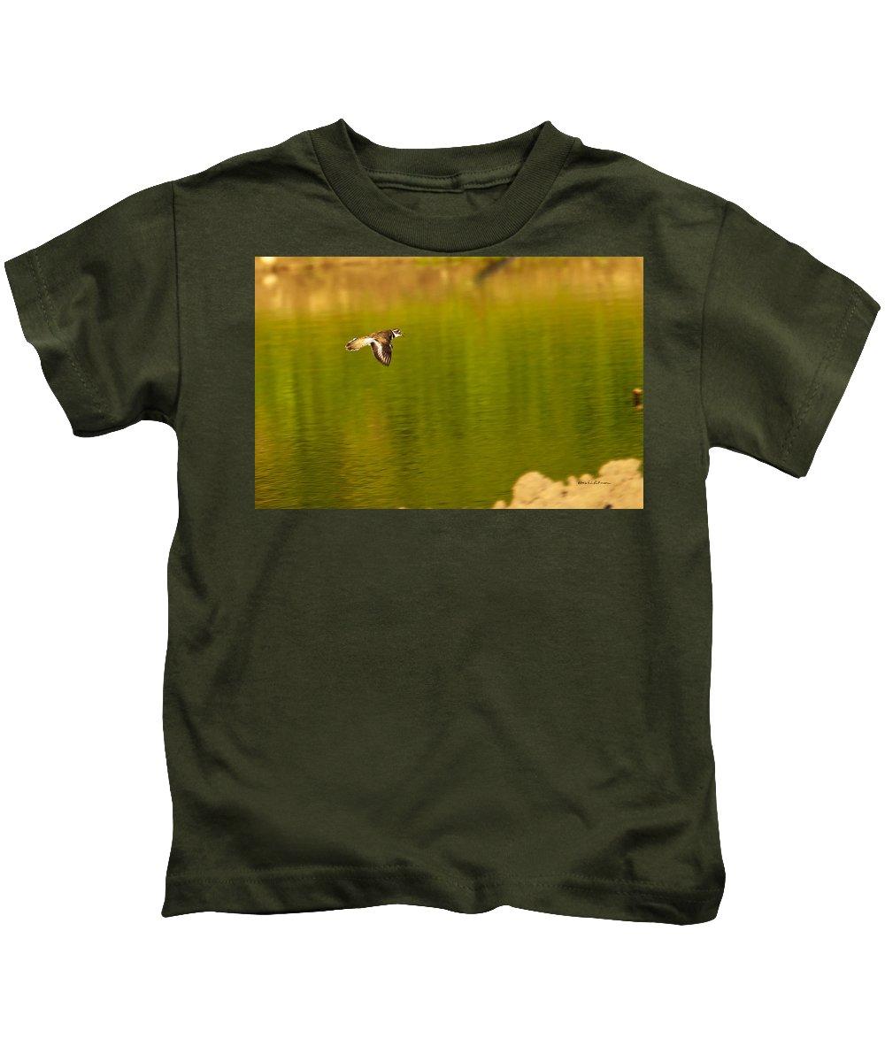 Killdeer Kids T-Shirt featuring the photograph Killdeer In Flight by Edward Peterson
