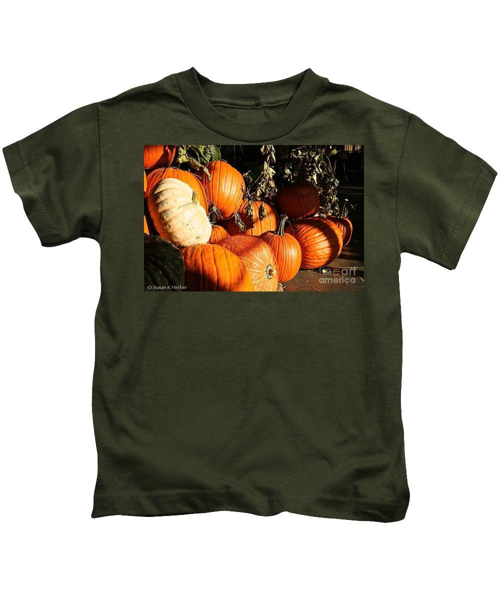 Outdoors Kids T-Shirt featuring the photograph Pumpkin Palooza by Susan Herber