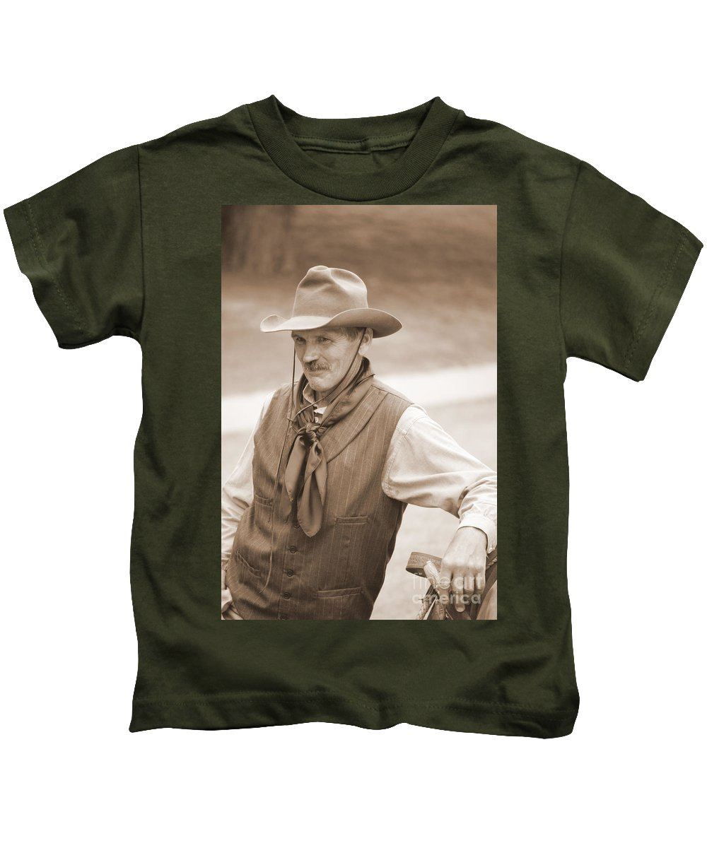 Cowboy Kids T-Shirt featuring the photograph Sly Cowboy by Anjanette Douglas