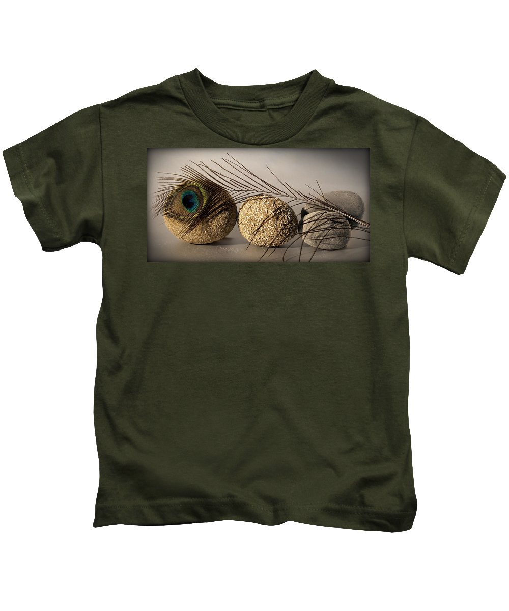 Photo Kids T-Shirt featuring the photograph stone fish - A a peacock feather and four pebbles become a sea creature in artist mind by Pedro Cardona Llambias