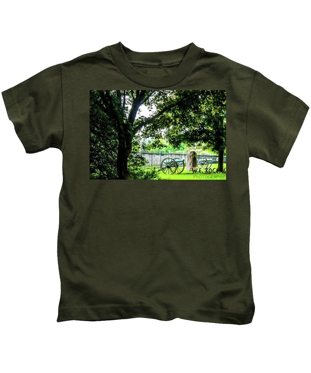This Is A Photo Of A Monument Marker And A Cannon At The Fence Of The Gettysburg National Cemetery Kids T-Shirt featuring the photograph Gettysburg National Cemetery by William Rogers