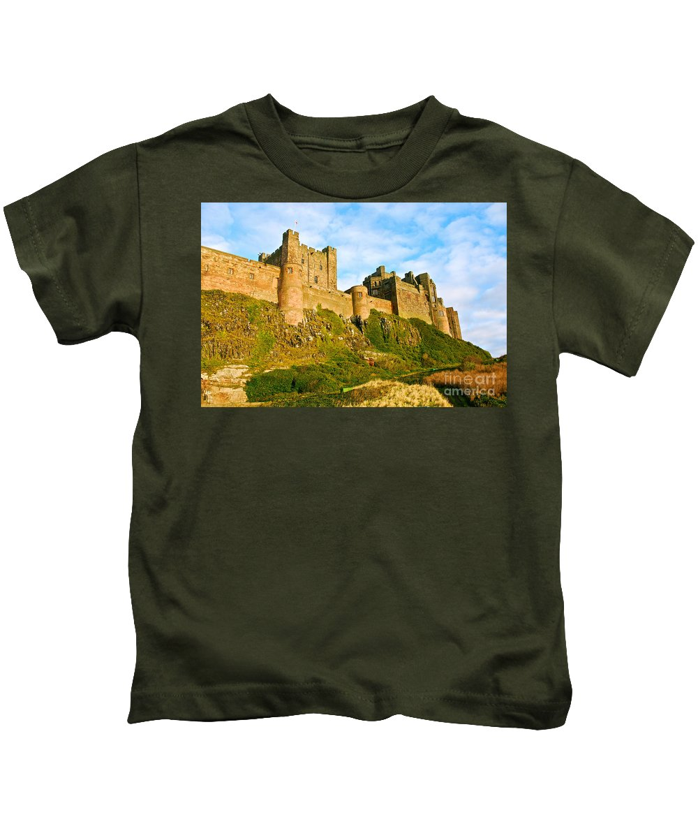 Bamburgh Castle Kids T-Shirt featuring the photograph Bamburgh Castle by Kayme Clark