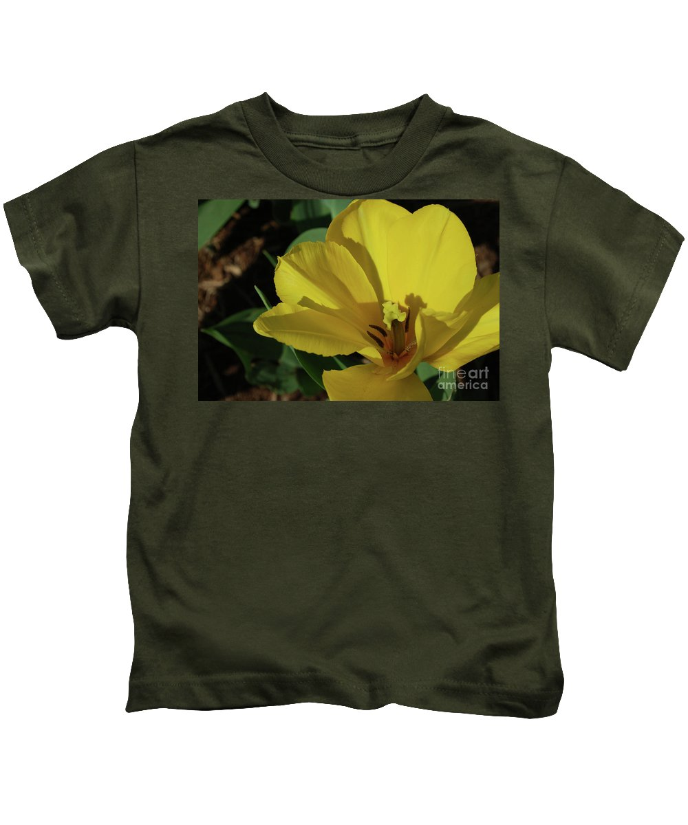 Tulip Kids T-Shirt featuring the photograph A Close Up Look At A Yellow Flowering Tulip Blossom by DejaVu Designs