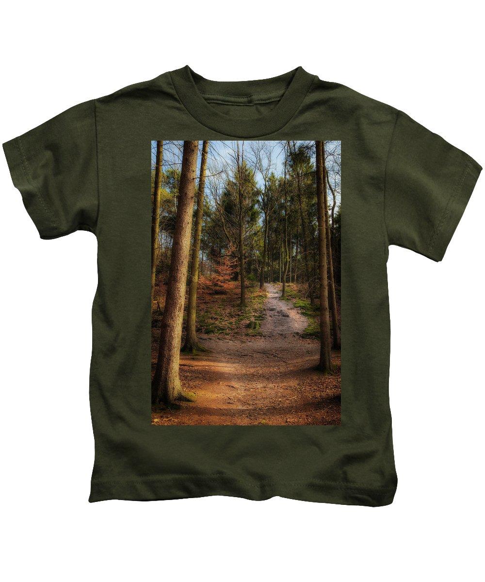 Gelderland Kids T-Shirt featuring the photograph A Path Through The Woods by Tim Abeln