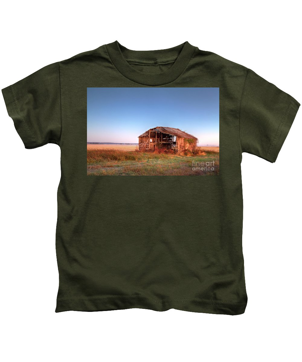 Driving Kids T-Shirt featuring the photograph Aftermath by Larry Braun