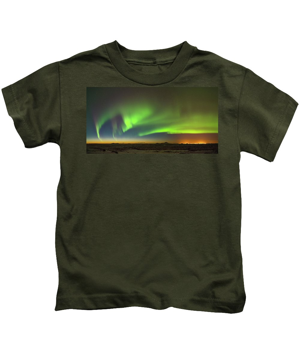 Iceland Kids T-Shirt featuring the photograph Aurora Above Keflavik In Iceland. by Andy Astbury