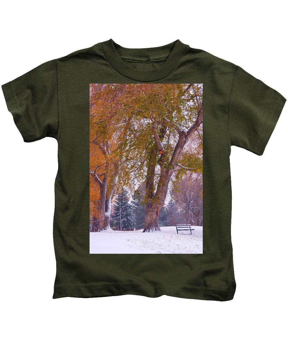 First Snow Kids T-Shirt featuring the photograph Autumn Snow Park Bench  by James BO Insogna