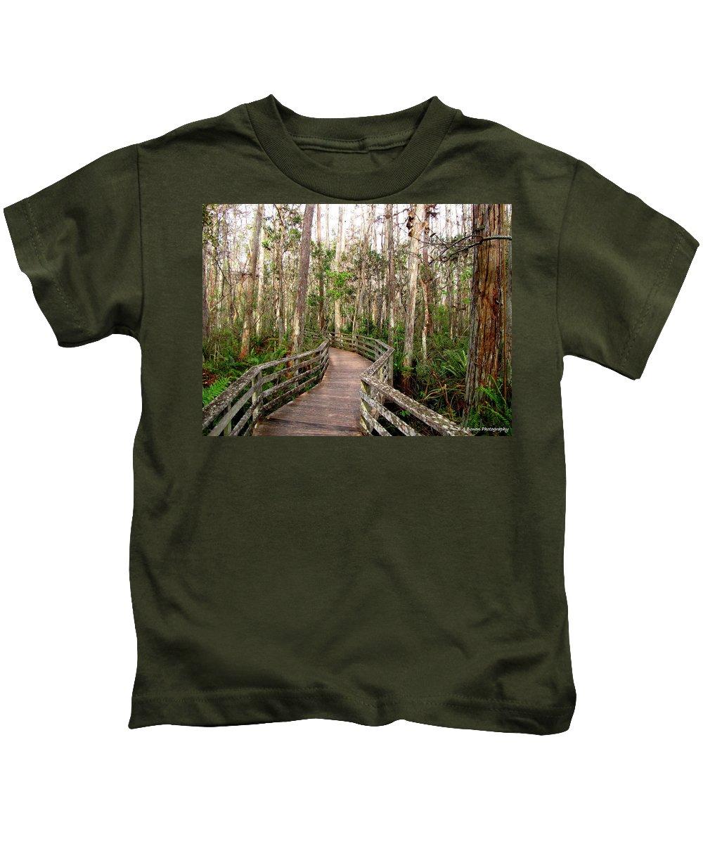 Boardwalk Kids T-Shirt featuring the photograph Boardwalk Through Corkscrew Swamp by Barbara Bowen