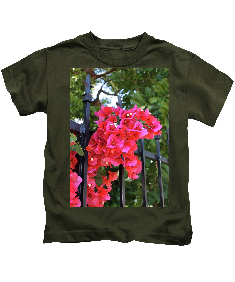 Bougainvillea Kids T-Shirt featuring the photograph Bougainvillea On Southern Fence by Carol Groenen