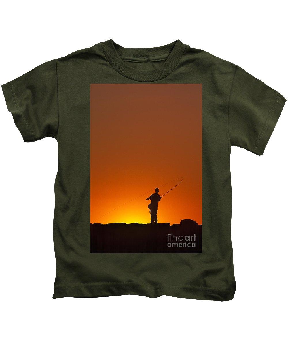 Youth Kids T-Shirt featuring the photograph Boy Fishing by John Greim