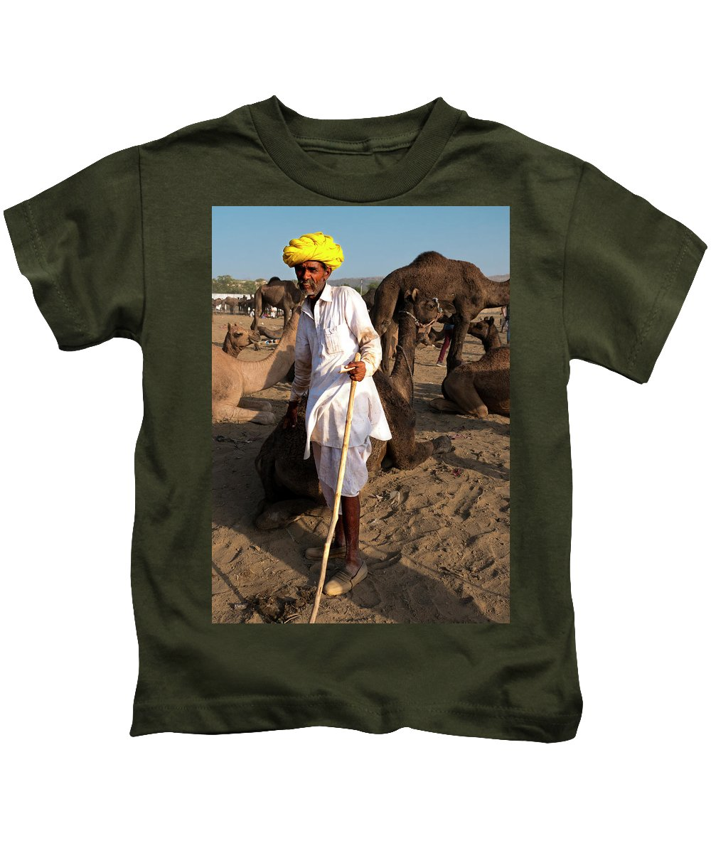 Camel Trader Kids T-Shirt featuring the photograph Camel Trader Pushkar by Doug Matthews