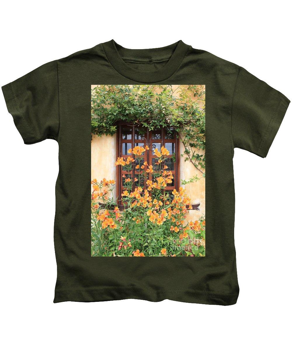 Alstroemeria Kids T-Shirt featuring the photograph Carmel Mission Window by Carol Groenen