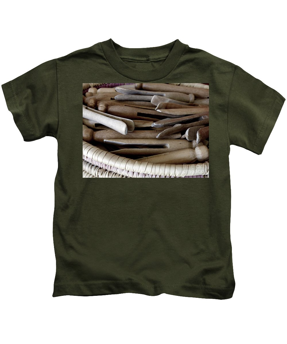 Clothes-pins Kids T-Shirt featuring the photograph Clothes-pins by Lainie Wrightson