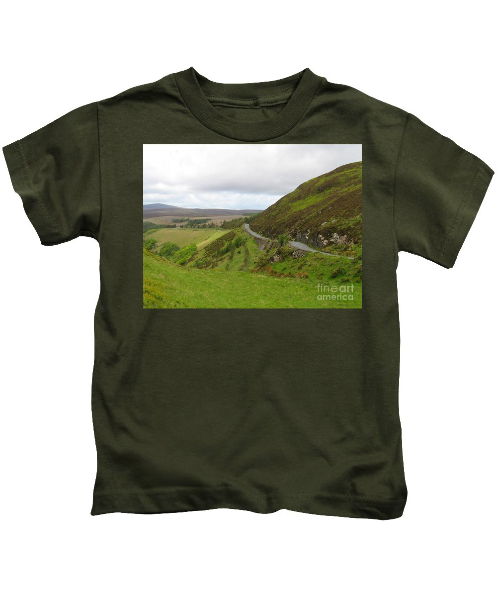 Road Kids T-Shirt featuring the photograph Countryside Road Bends Around Hill by Four Stock