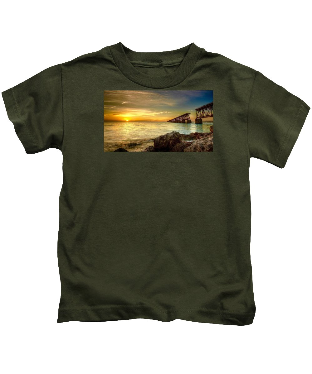 Bahia Honda State Park In The Florida Keys. Facing The Sunset With The Old Abandoned Rail Bridge Built By Henry Flagler Kids T-Shirt featuring the photograph Flagler Bridge At Sunset by Mark Reinnoldt