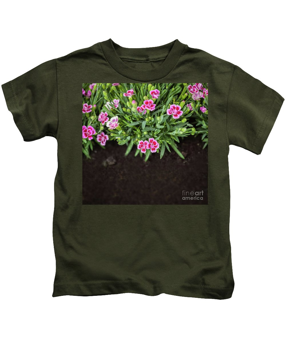 Grass Kids T-Shirt featuring the photograph Flowers In Grass Growing From Natural Clean Soil by Michal Bednarek