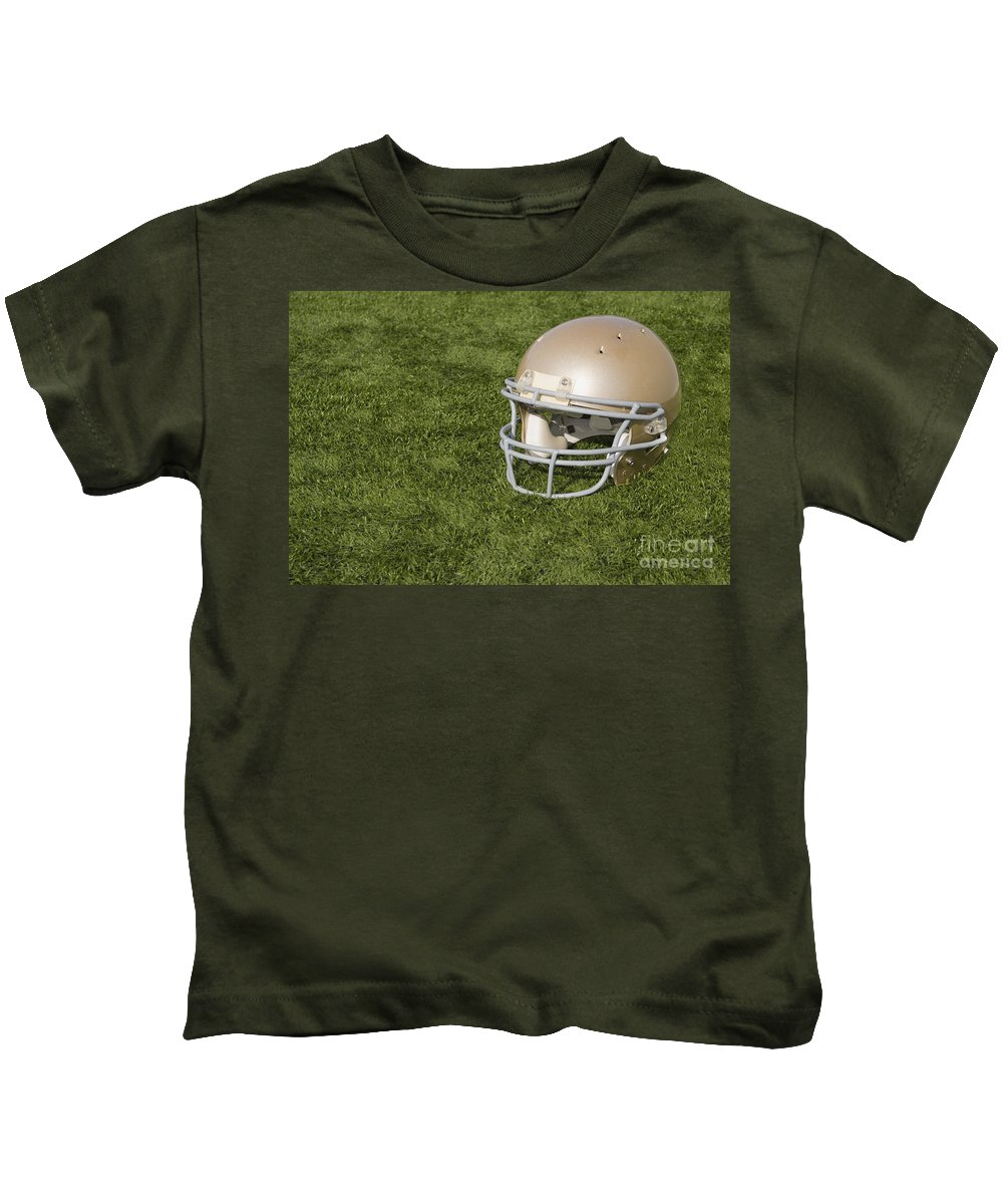 America Kids T-Shirt featuring the photograph Football Helmet On Artificial Turf by SAJE Photography
