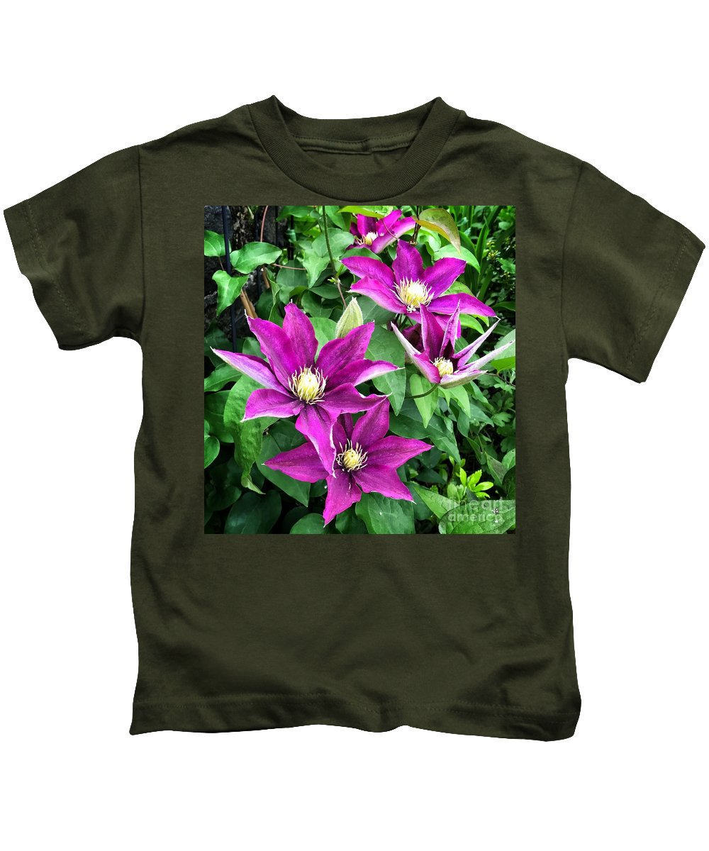 Fuchsia Clematis Flowers Kids T-Shirt featuring the photograph Fushia Clematis Flowers by Jane Maurer