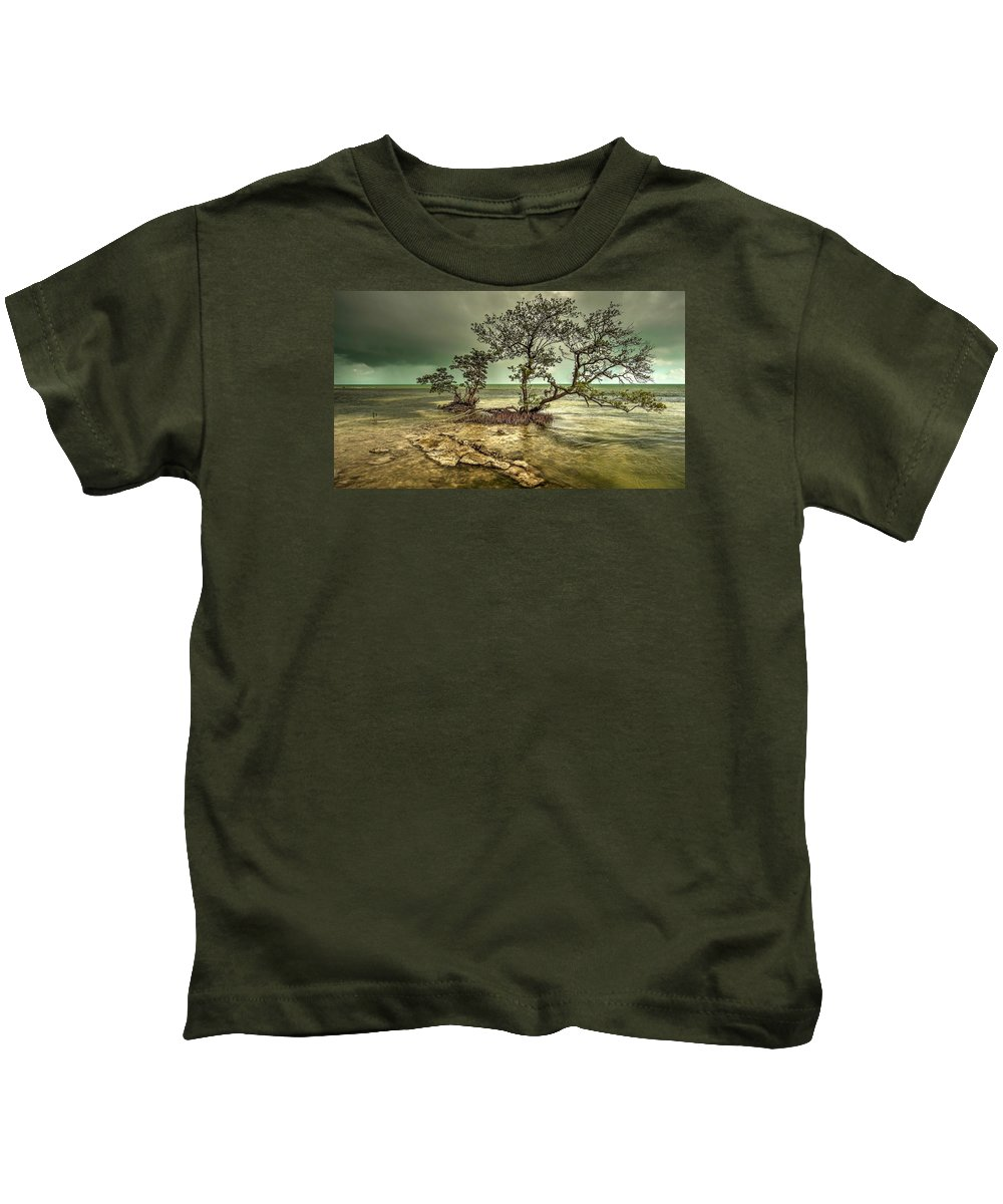 This Is A Mangrove Tree Growing From The Shallow Coastline Of Geiger Key In The Lower Florida Keys Kids T-Shirt featuring the photograph Geiger Key Shoreline by Mark Reinnoldt