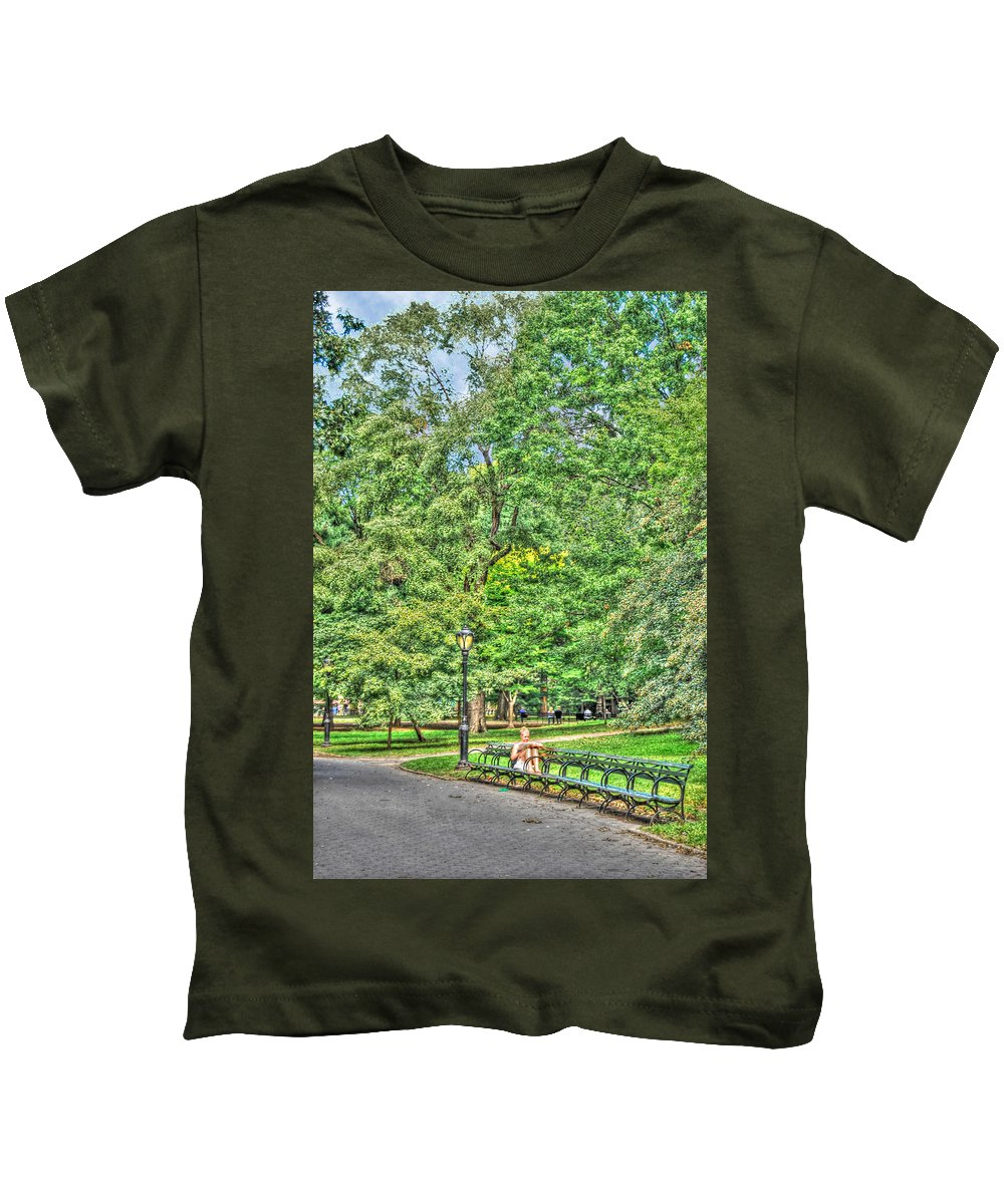Central Park Kids T-Shirt featuring the photograph Girl Uninterrupted In Central Park by Randy Aveille