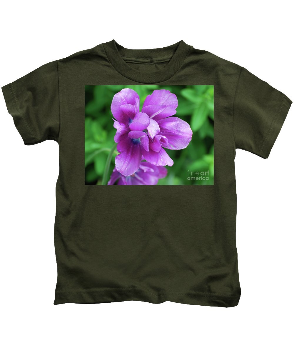 Tulip Kids T-Shirt featuring the photograph Gorgeous Flowering Purple Tulip Flower Blossoms In A Garden by DejaVu Designs